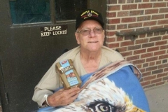 Veteran with gift of eagle blanket and chocolates