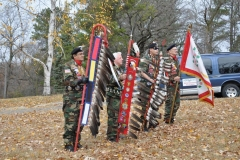 veterans with ceremony flags and feathers
