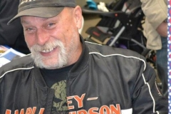 man in harley davidson jacket smiling