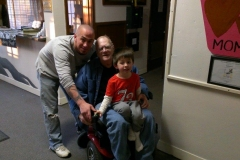 man in wheelchair with son and grandson