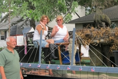 two women riding on the EHN parade float